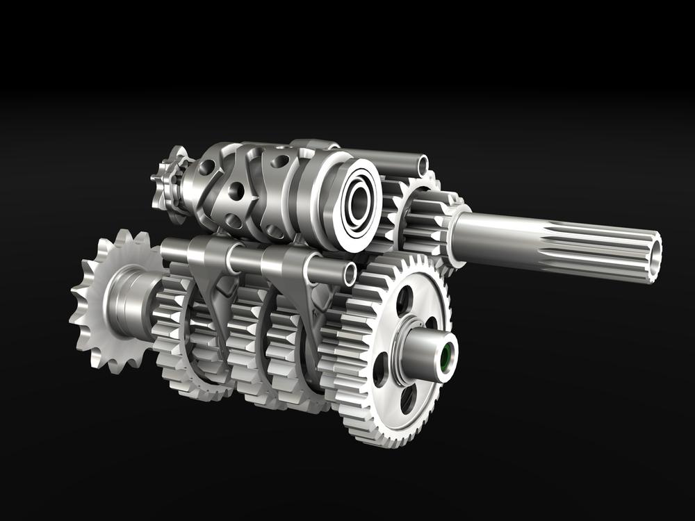 In questa splendida immagine dei componenti del cambio della Ducati Panigale si possono notare chiaramente la conformazione e la disposizione del tamburo selettore e delle forcelle di innesto delle marce