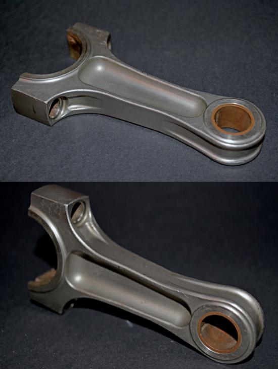 Foto di una biella in lega di titanio della 312. Lo spinotto ha un diametro di 18 mm e l'interasse testa-piede è sensibilmente superiore al doppio della corsa